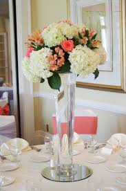 deercreek country club coral u0026 white tall floral centerpiece