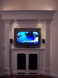 flat screen tv over the fireplace