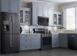 what color cabinets go with black appliances kitchen trend colors brands cabinet for west loves beach steel usa