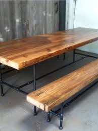 plumbing pipes and wood pieces made into picnic bench tafels
