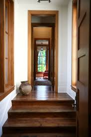 stained floor and doors trim and white baseboards beautiful