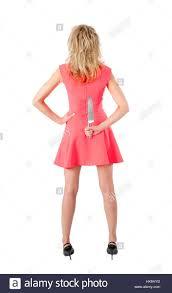 pretty slender woman hidden kitchen knife behind back stock photo