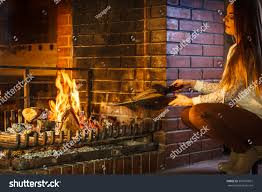 woman fireplace making fire bellows young stock photo 361837961