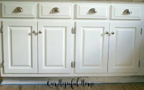 our hopeful home how to install farmhouse kitchen towel bars white farmhouse kitchen cabinets with brushed nickel knobs and cup pulls
