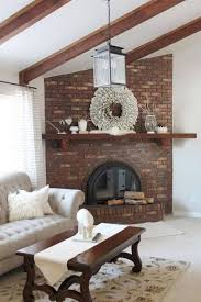 curved brick corner fireplace design with open shelf and wreath