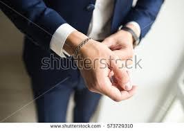 man hand bracelet images Mens hand suit silver bracelet on stock photo royalty free jpg