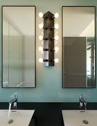 Vertical Bathroom Lights by 9 Creative Bathroom Lighting Interior Design Ideas