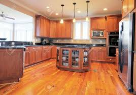 Kitchen Hardwood Flooring View Of A Large Upscale Kitchen With Hardwood Floors And Modern