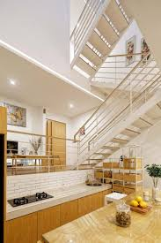 multiple mezzanines are connected by an open stair in jakarta house