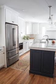 white kitchen cabinets with blue island our kitchen remodel sources revealed lovely lucky