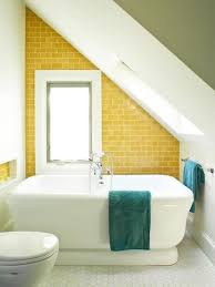 adorable small attic bathroom with yellow subway tile for the