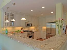 white kitchen cabinets with gray granite countertops u2014 smith