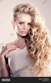 model with long hair blonde waves curls hairstyle hair salon updo