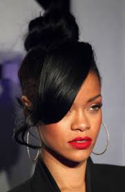 curly hair in high bun with bang bun hairstyles with bangs for black women trend hairstyle and