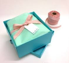 wrapped gift boxes gift wrapping project lining gift boxes with tissue and ribbon