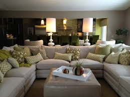 family room sectional white sofa white accessories white lamps
