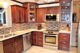 decorations brown oak kitchen cabinet and beige tile backsplash