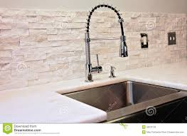industrial style kitchen faucet stacked stone backsplash on new modern kitchen detail sink marble