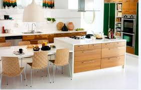 ikea kitchen islands with seating this white ikea kitchen island includes a cooktop to provide an