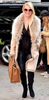 jessica simpson wears sheer top black leather pants suede fur
