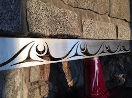 custom steel fireplace insert with subtle westcoast native coast