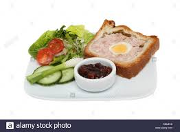 cuisine gala gala pie salad and pickle on a plate isolated against white stock