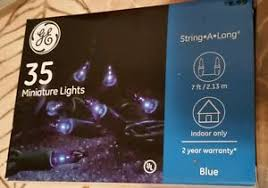 blue 35 count ge lights on green wire string a new