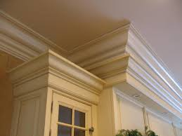 Kitchen Molding Cabinets by Adding Tall Crown Molding Then Painting Cabinets Link To Tile