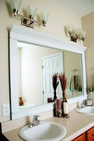 Frame For Bathroom Mirror by Framing Mirror Using Crown Molding And Spray Paint So Much