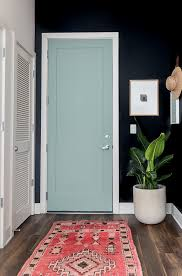 a minimal modern entryway makeover from white walls to dark and