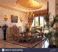 spanish dining room furniture lime washed chairs and glass table in opulent spanish dining room