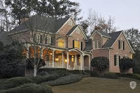 wrap around front porch stately brick estate with wrap around front porch in johns creek us