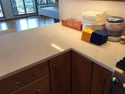 quartz countertops with oak cabinets wl cm stone works granite countertops chicago kitchen
