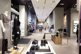 interior of brand new fashion clothes store stock photo picture