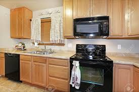 color kitchen cabinets with black appliances light color kitchen with black appliances