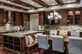 custom wood cabinets along with a large island with built in