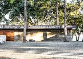 wernerfield uses concrete and weathered steel to create texas home