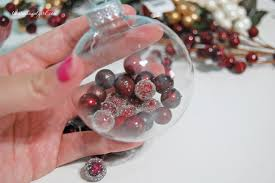 fill glass ornament with berries the ornament