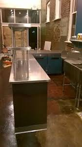 front counter with stainless countertop u0026 overshelves and