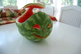 carve a watermelon into a creative shape for a fun table centerpiece