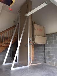 a bruno vertcal platform lift installed in a garage with custom