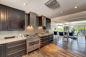 contemporary kitchen with breakfast bar handscraped wood floors