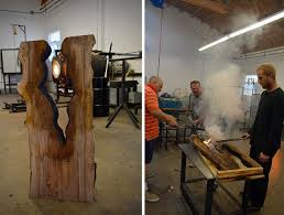 artist blows glass vases directly into slabs of live edge wood
