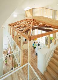 transforms japanese house into kindergarten with a two storey slide