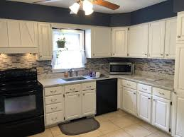 white kitchen cabinets refinishing cabinets painted white and new countertops monk s in nj