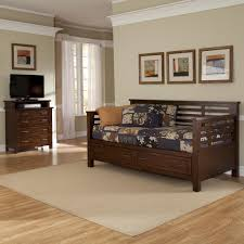 dark brown wooden daybed with double storages and dark blue bed