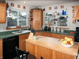 white kitchen cabinets with green granite countertops what to do with a kitchen with wood cabinets and green