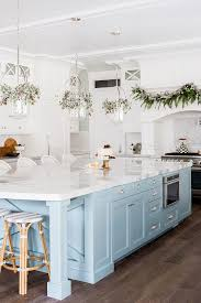 blue kitchen island kitchen with white cabinets and light blue island pinned to