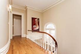 traditional hallway with crown molding hardwood floors in grand