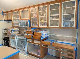 where can i get kitchen cabinet doors painted painting cabinets how the pros do it paper moon painting